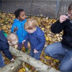 Benny, Finn, and Jasmine work together with teacher Ben to try smelling and stacking the trunks as well.
