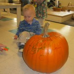 Right away, we offered markers to draw on the big pumpkin.