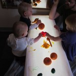 Next, we decided to try some painting on the light table...