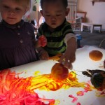 Joshua enjoyed rolling the small pumpkins in the paint.