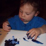 At first he repetedly picked up some paint with his fingers and tried putting them in his mouth.