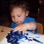Jameson spent a while picking up small amounts of paint with his fingers.