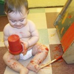 Eloise spent much of her time exploring the paint bucket, flipping it over, patting and shaking it.