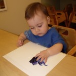 Eloise's first experience with a blob of paint on her paper. She was hesitent to touch it at first.